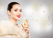 beautiful glamour woman holding champagne