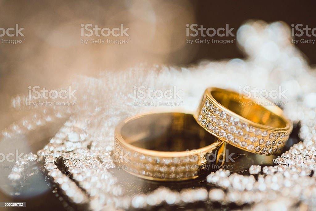 beautiful gold wedding ring with diamonds stock photo