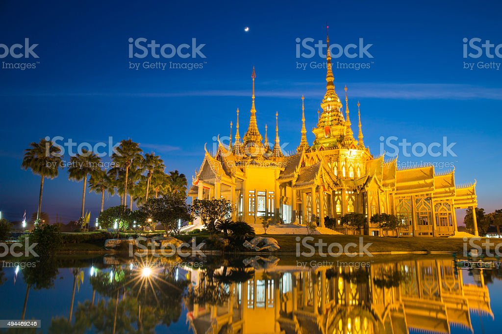 Beautiful golden buddhist temple in night time stock photo