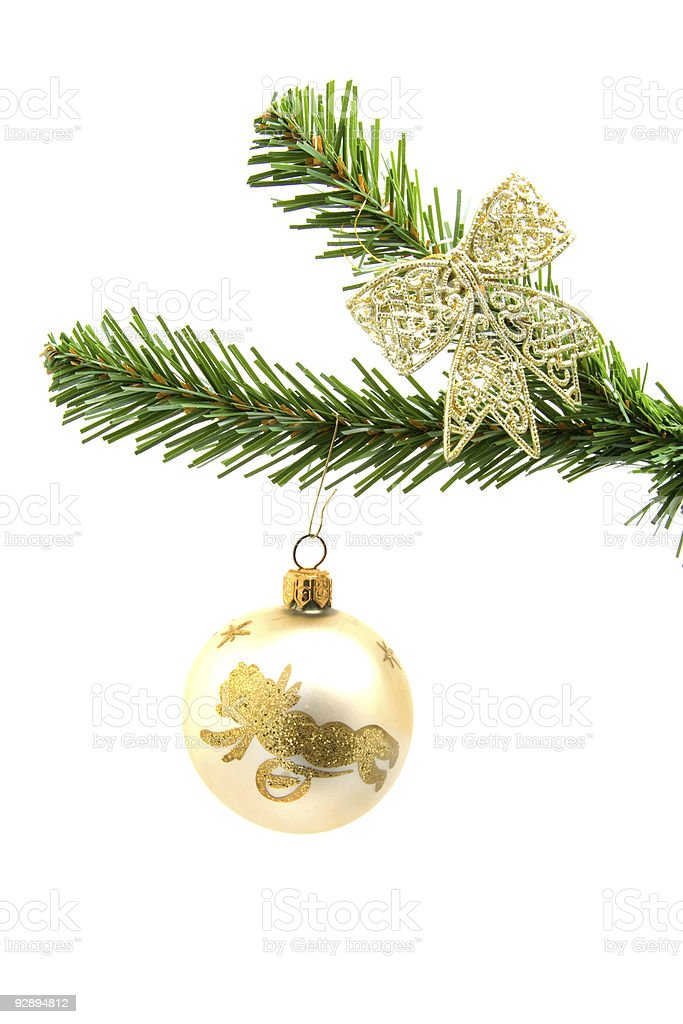 beautiful golden christmas ball on a tree stock photo