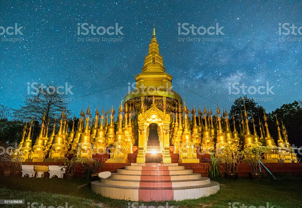 Beautiful golden pagoda of Pa sawangboon temple with milky way stock photo