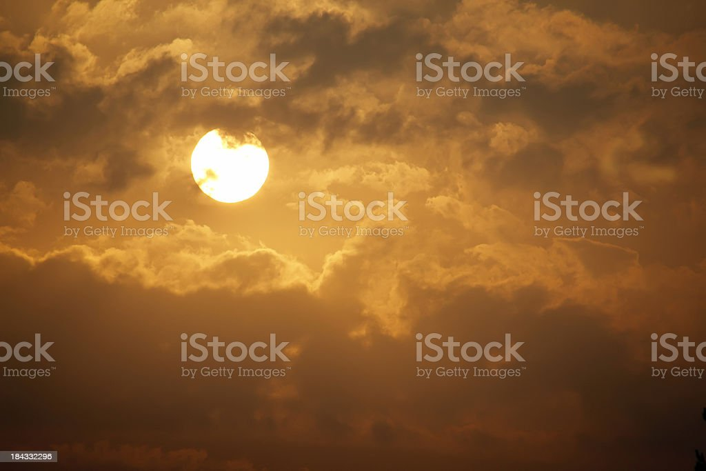 Beautiful Golden Sunrise With Large yellow Sun and Clouds royalty-free stock photo