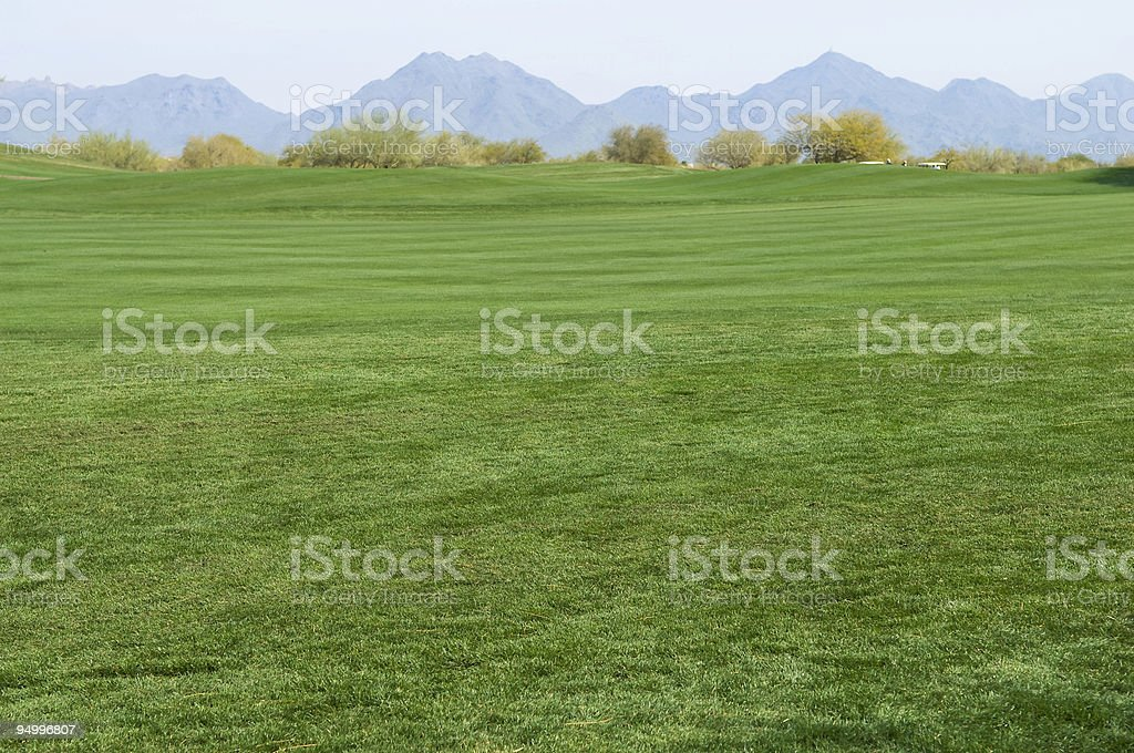 Beautiful Golf Course and Scenic Landscape with Mountains royalty-free stock photo