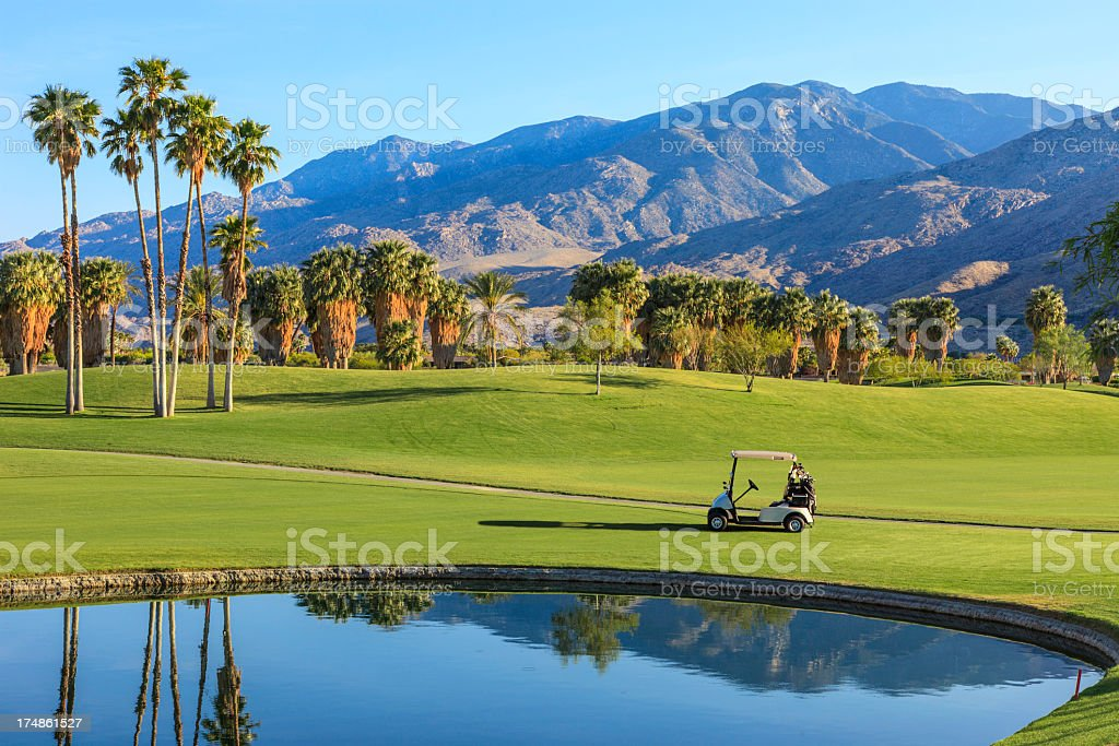 Beautiful golf course's lake and golf cart in California stock photo