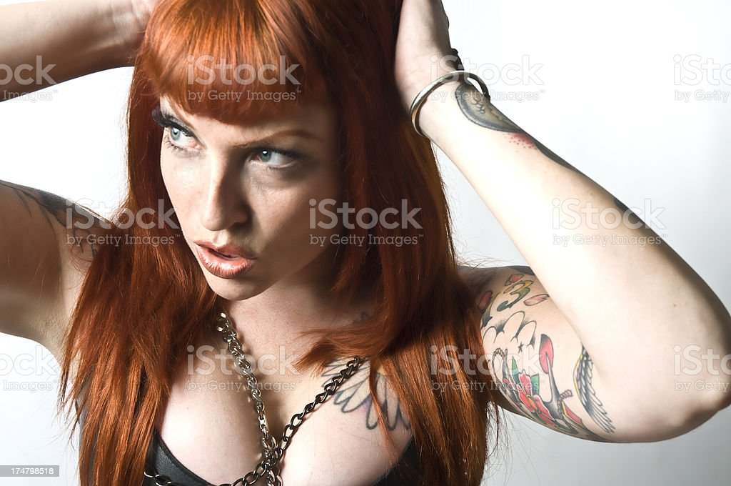 Beautiful Goth Tattoo Female Orange Hair Blue Eyes Headshot royalty-free stock photo