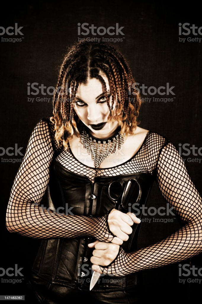 Beautiful Goth Woman with Large Scissors stock photo