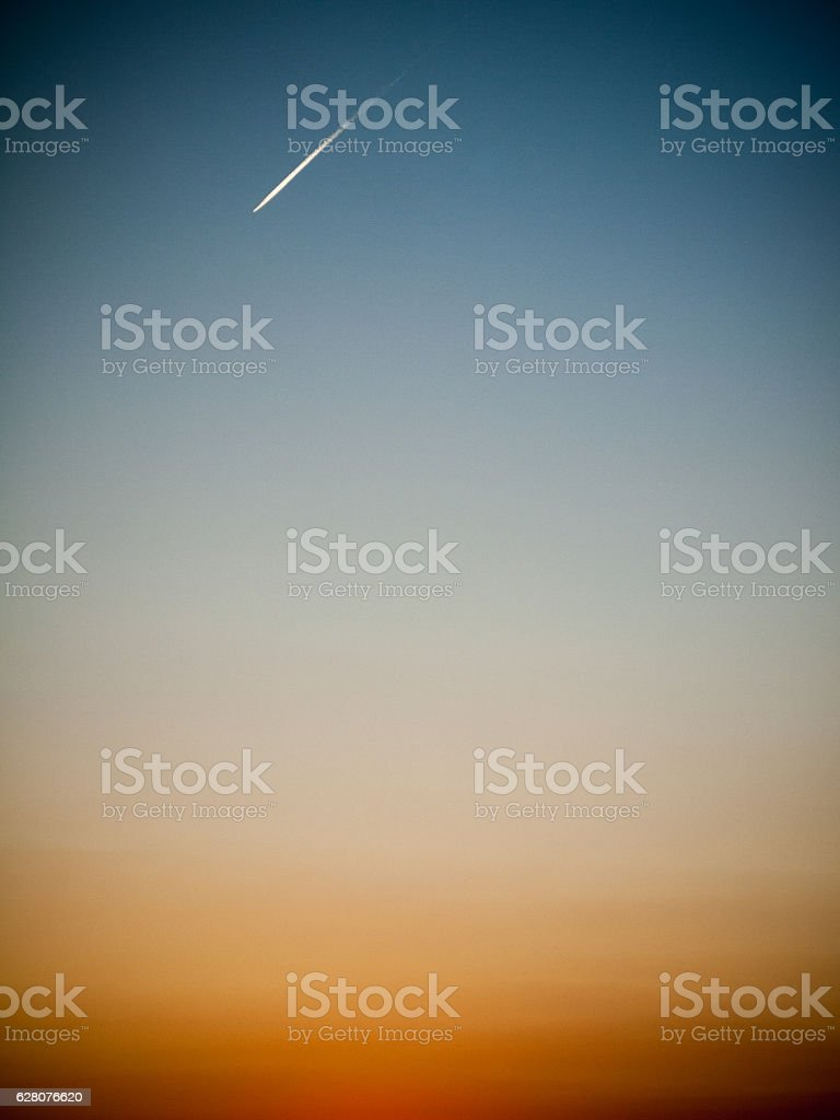 beautiful gradient sky with jet plane and conttrail stock photo