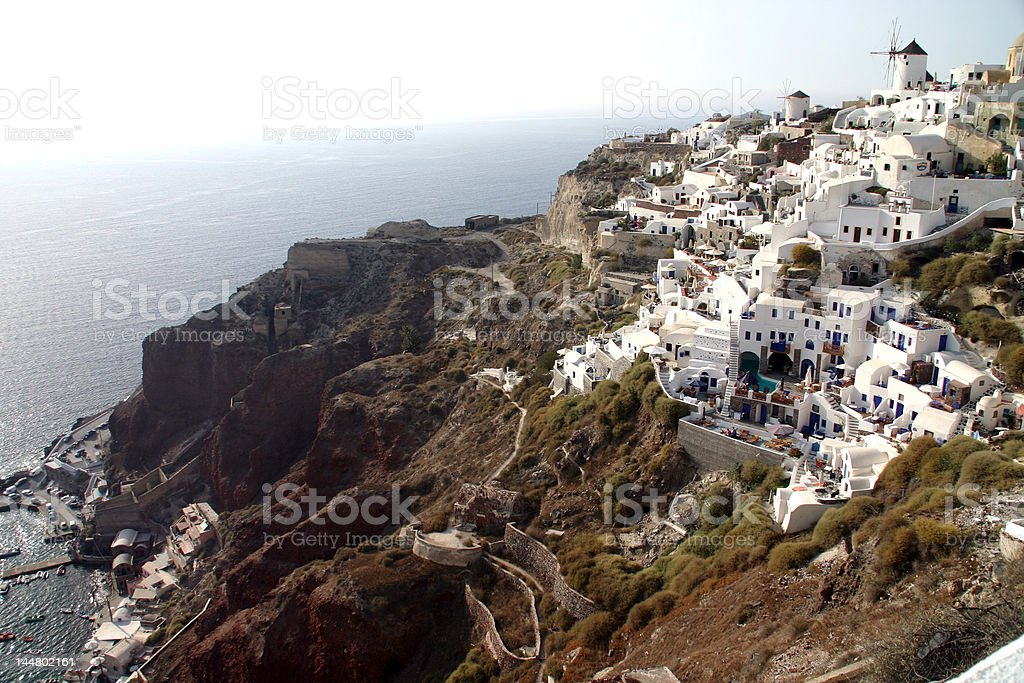 Beautiful Greek mountainside with houses, churches, and windmills royalty-free stock photo