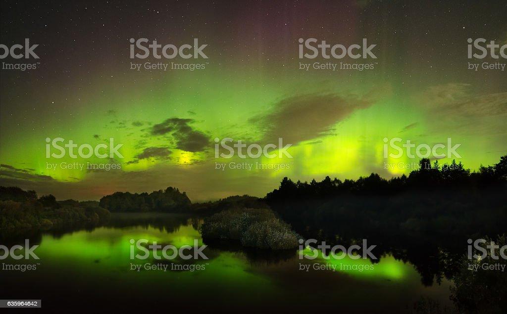 beautiful green and red aurora dancing stock photo