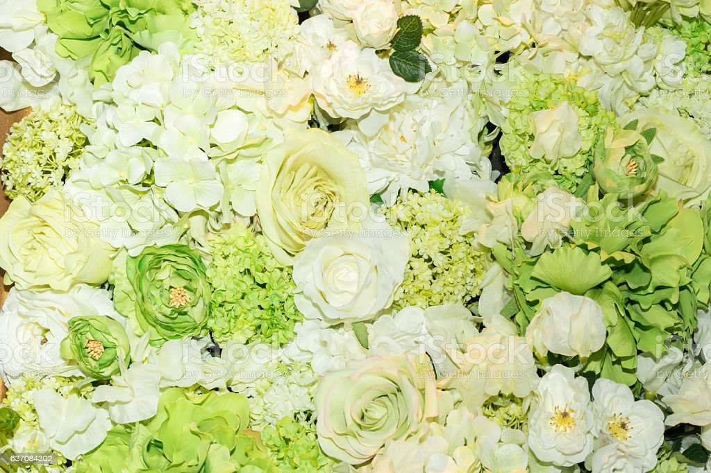 Beautiful green artificial flowers background. stock photo