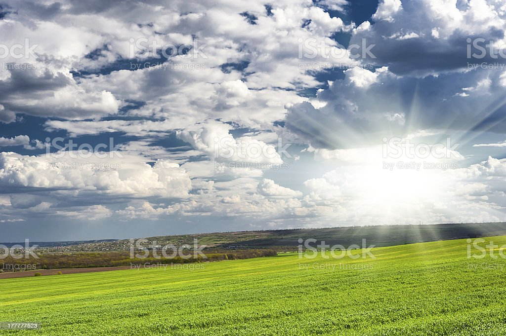 beautiful green field and clouds royalty-free stock photo