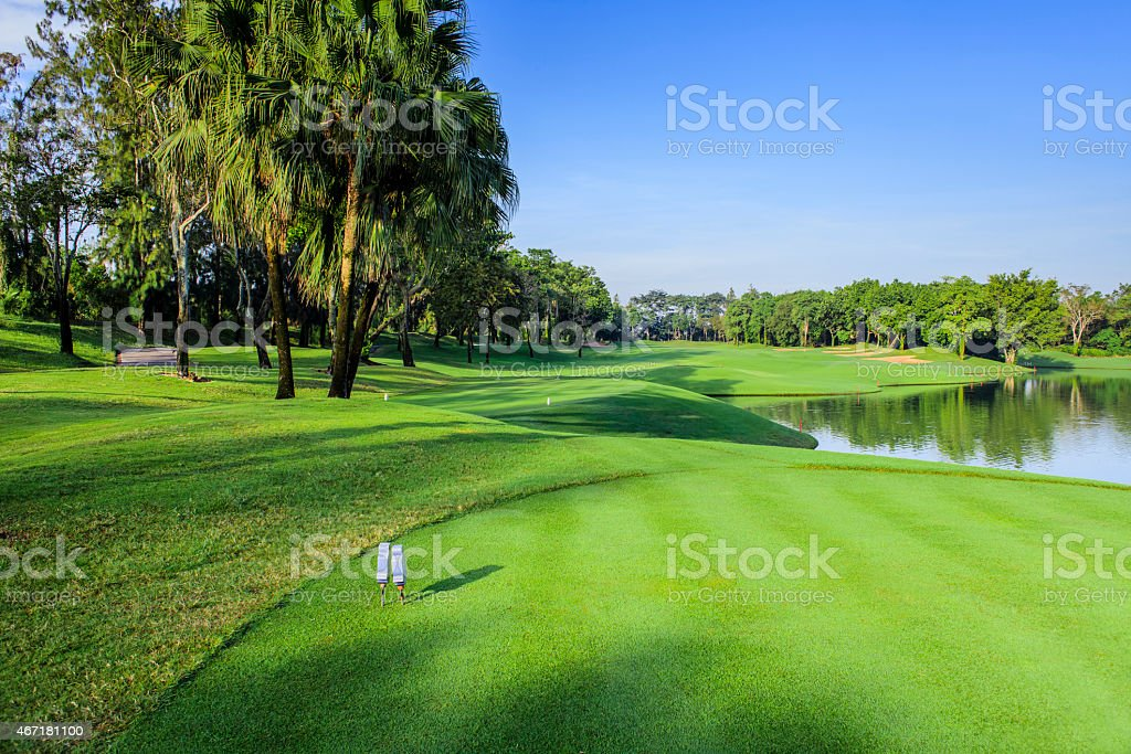 Beautiful green golf course in a sunny day, Thailand stock photo