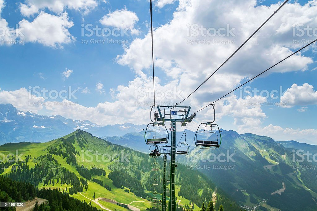 Beautiful green landscape with white clouds in the French Alps stock photo