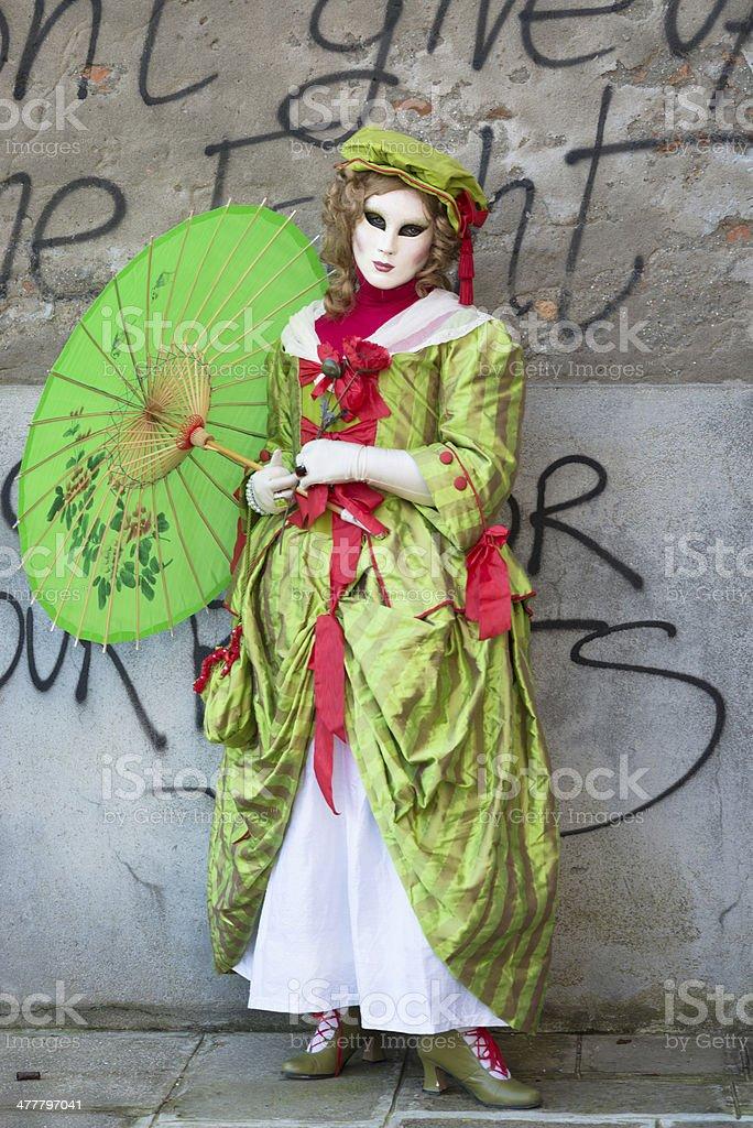 Beautiful Green Mask, Venice Carnival at Arsenale, Italy, Europe stock photo