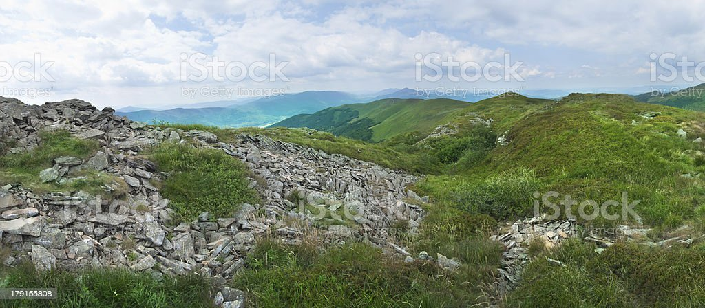 Beautiful green mountain panorama with blue sky above royalty-free stock photo