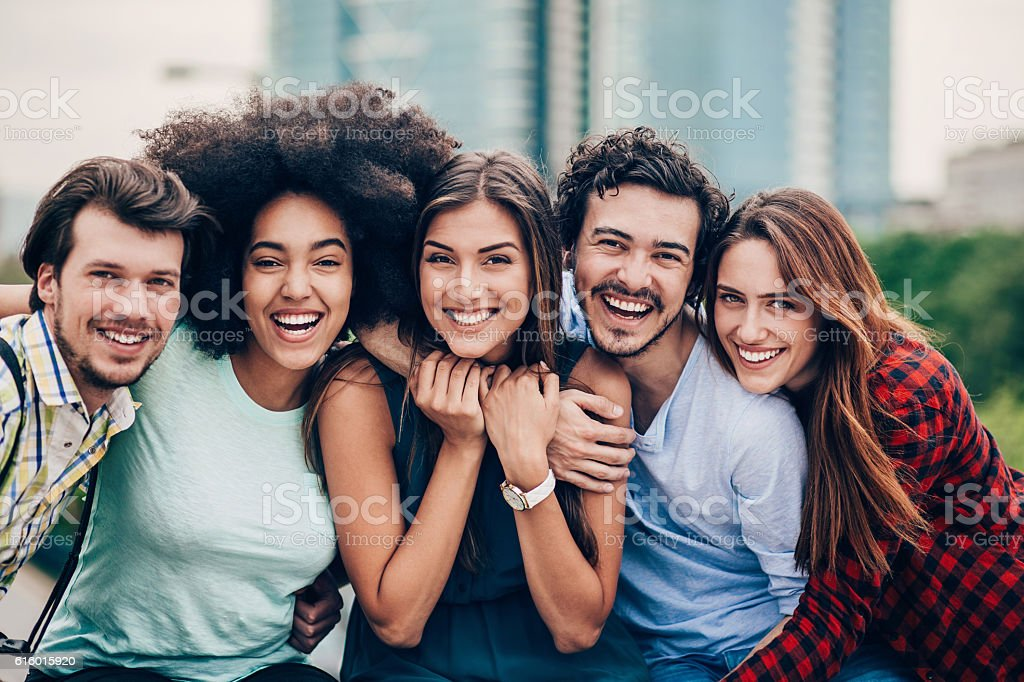 Beautiful group of friends outdoors in the city stock photo