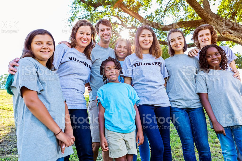 Beautiful group of happy volunteers outside stock photo