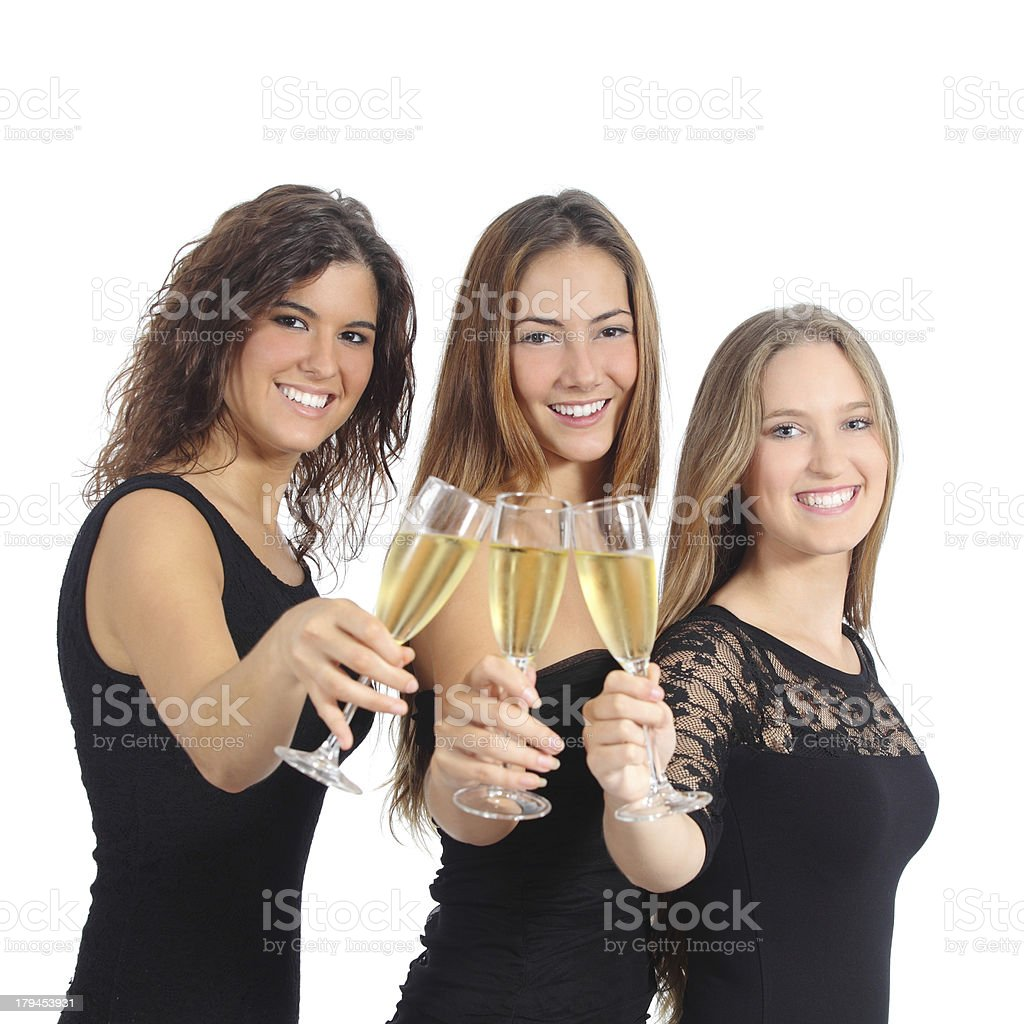 Beautiful group of three women toasting with champagne royalty-free stock photo