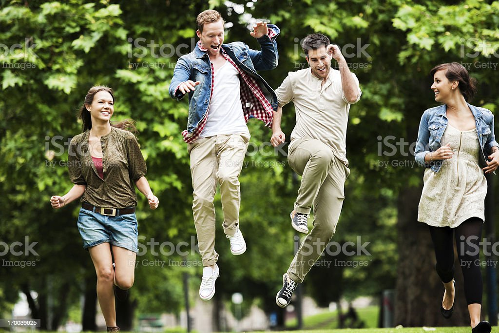 Beautiful group of young people jumping. stock photo