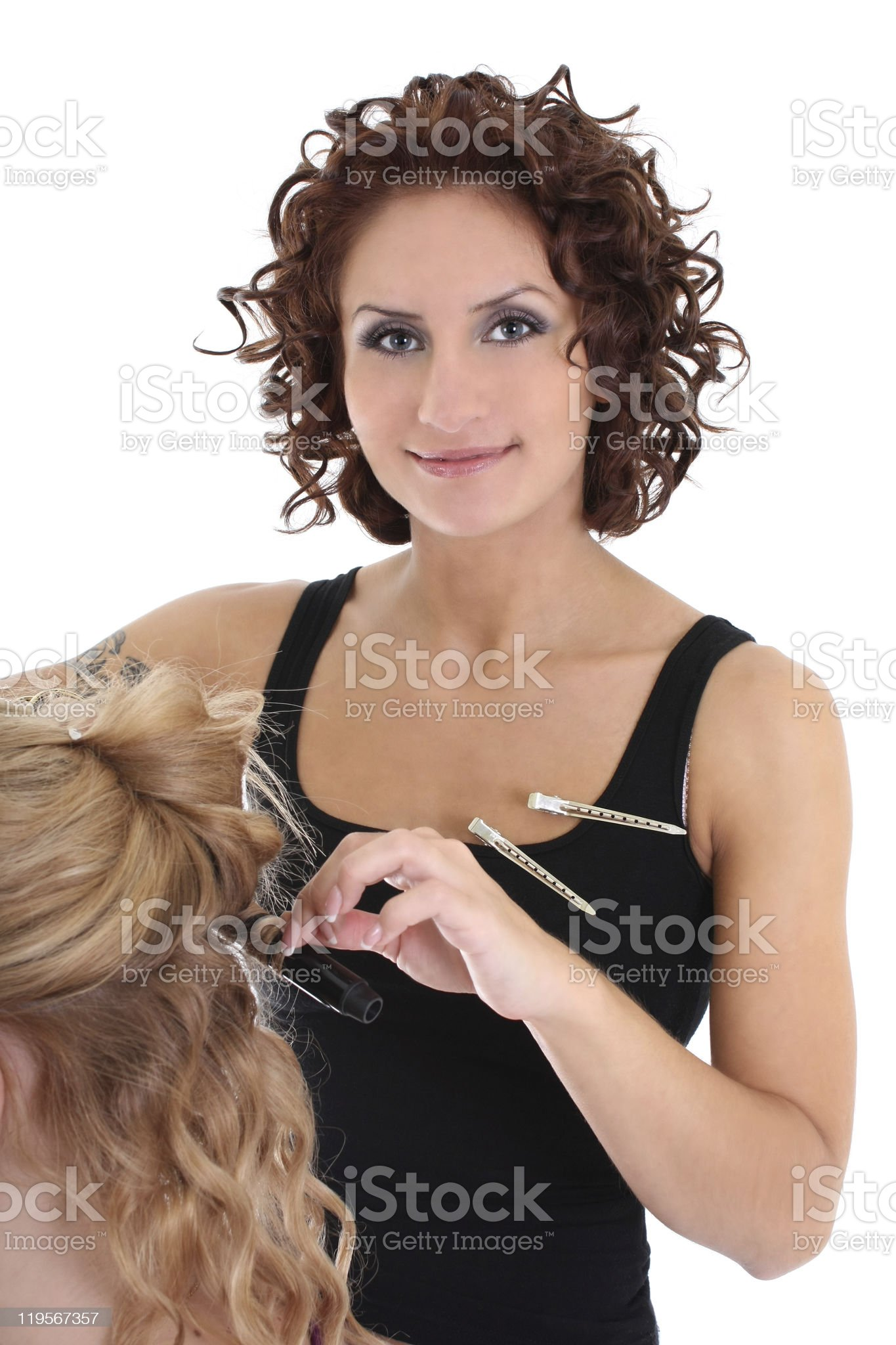 beautiful hairdresser with client over white royalty-free stock photo