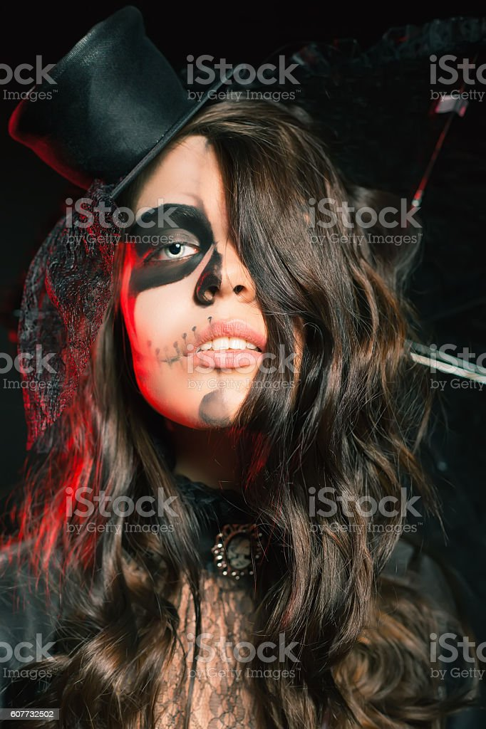 Beautiful hairstyle and scary makeup at Halloween party stock photo