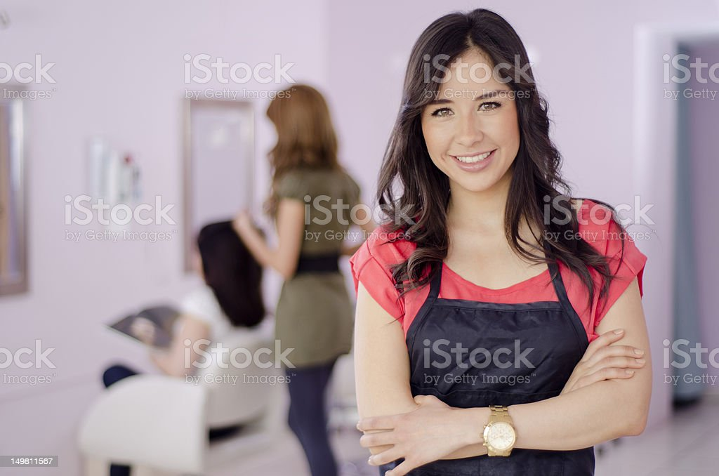 Beautiful hairstylist greeting customers royalty-free stock photo