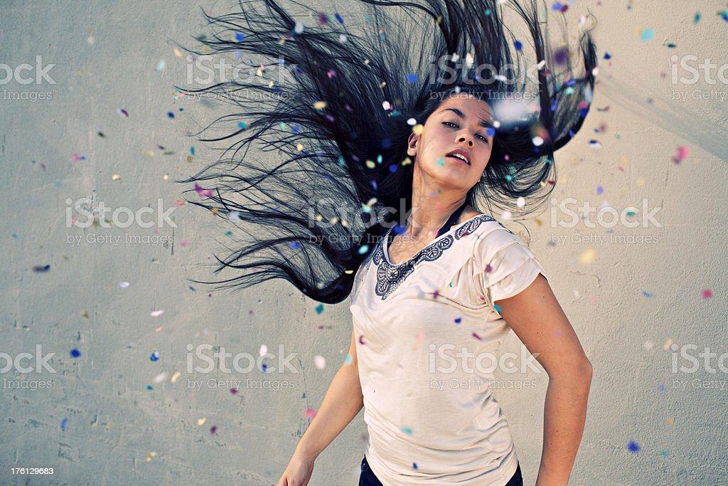 beautiful half asian woman throwing her hair confetti royalty-free stock photo