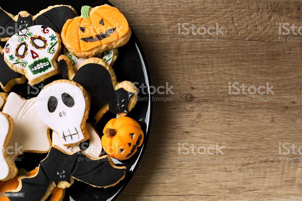 Beautiful halloween cookies on black plate stock photo