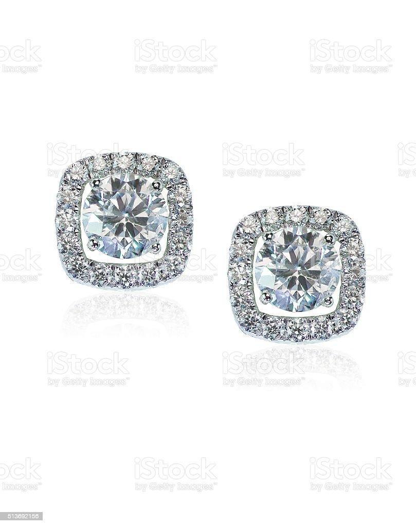 Beautiful Halo Diamond Stud earrings with reflection stock photo