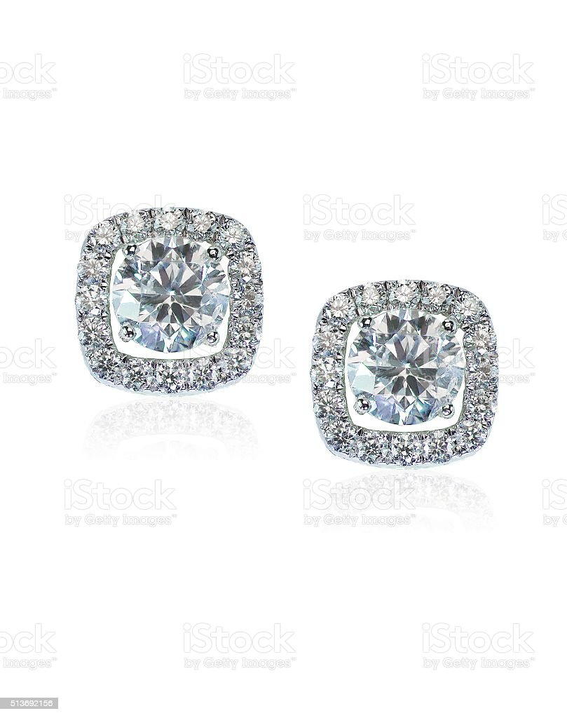 Beautiful Halo Diamond Stud earrings with reflection stock photo