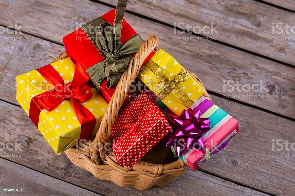 Beautiful handmade wicker basket with gifts. stock photo
