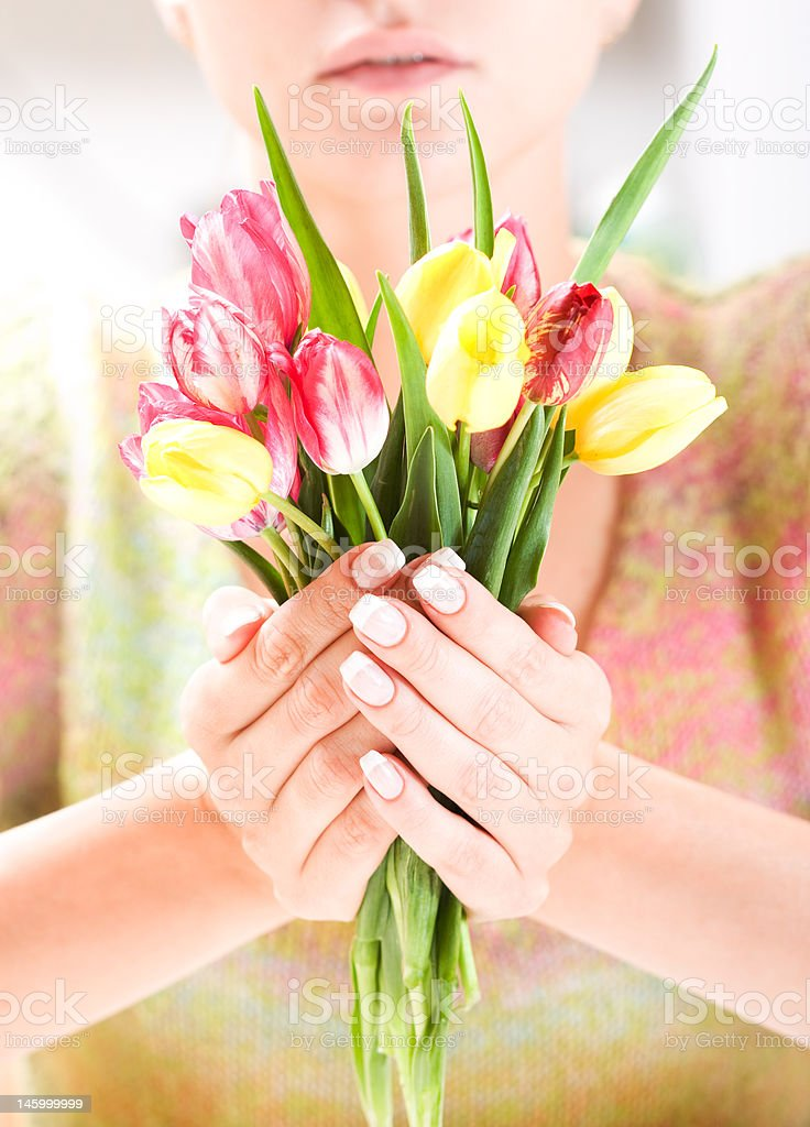 Beautiful hands with bunch of tulips royalty-free stock photo