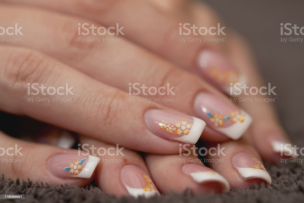 Beautiful hands with french manicure on black background royalty-free stock photo