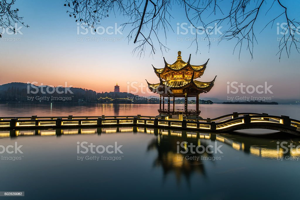 beautiful hangzhou in sunset and ancient pavilion stock photo