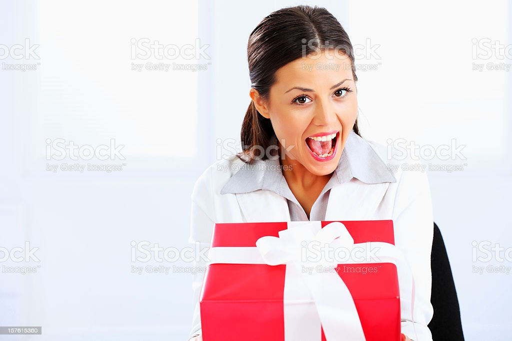 Beautiful happy business woman with present. royalty-free stock photo