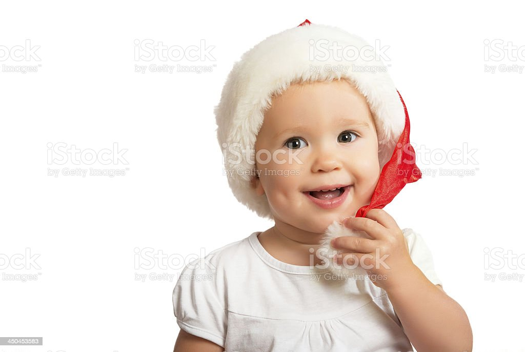 Beautiful happy funny baby in a Christmas hat  isolated royalty-free stock photo