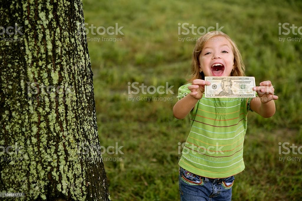 Beautiful happy little girl with dollar note royalty-free stock photo