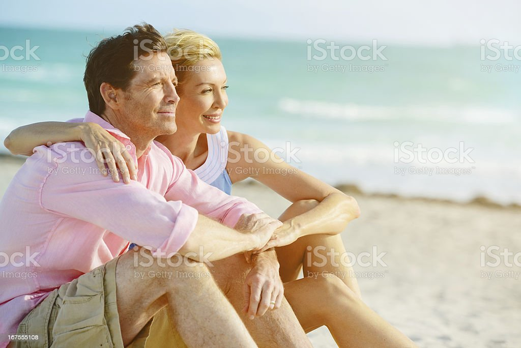 Beautiful Happy Mature Couple Embracing on the beach royalty-free stock photo