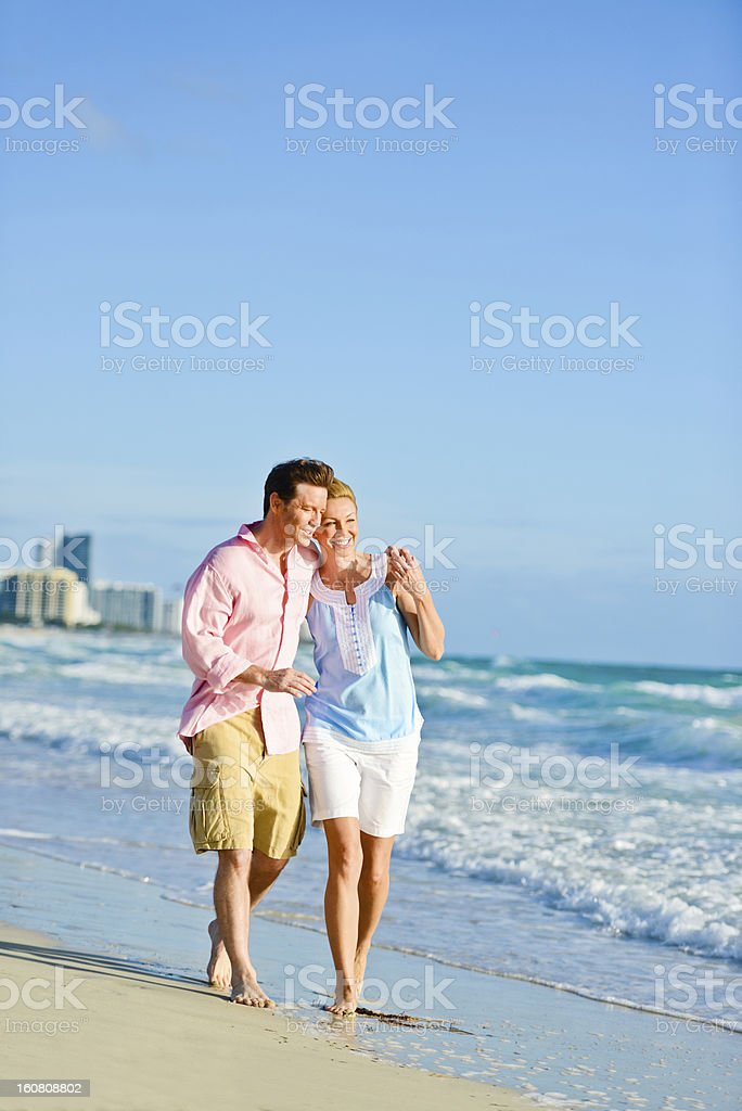Beautiful Happy Mature Couple Walking on the beach royalty-free stock photo