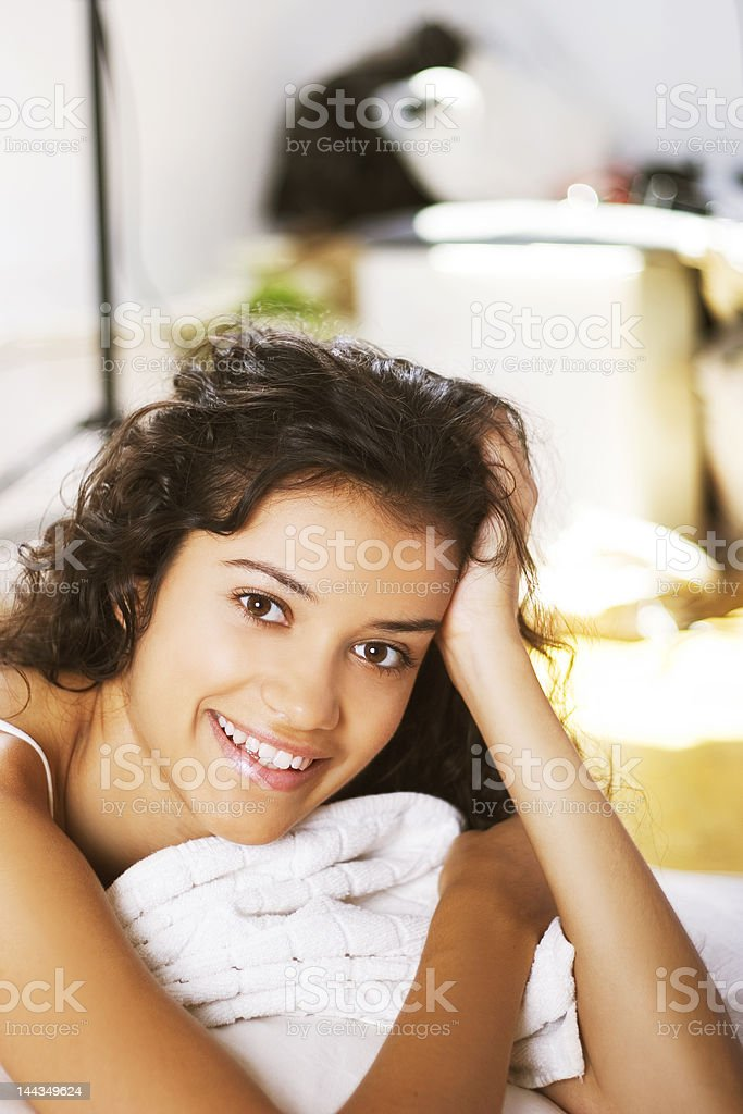 beautiful happy young girl in bed royalty-free stock photo