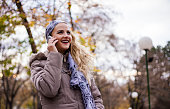 Beautiful happy young woman with smartphone.