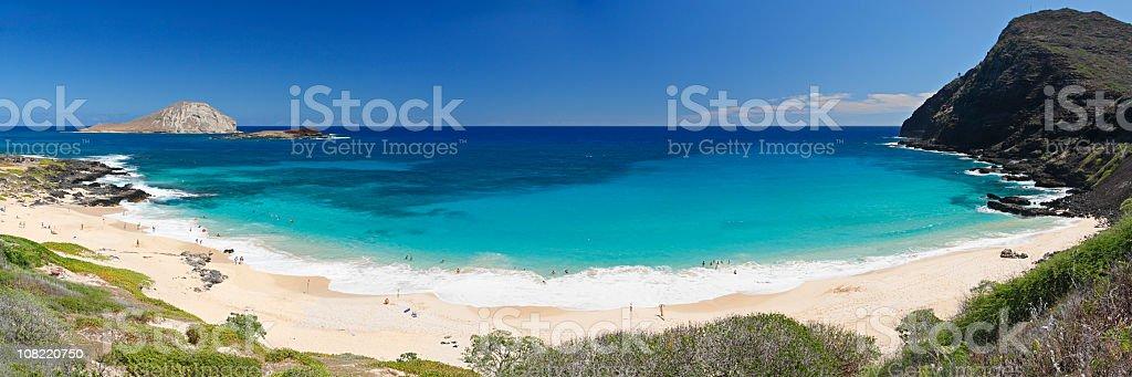 A beautiful Hawaiian beach with hills, white sand royalty-free stock photo