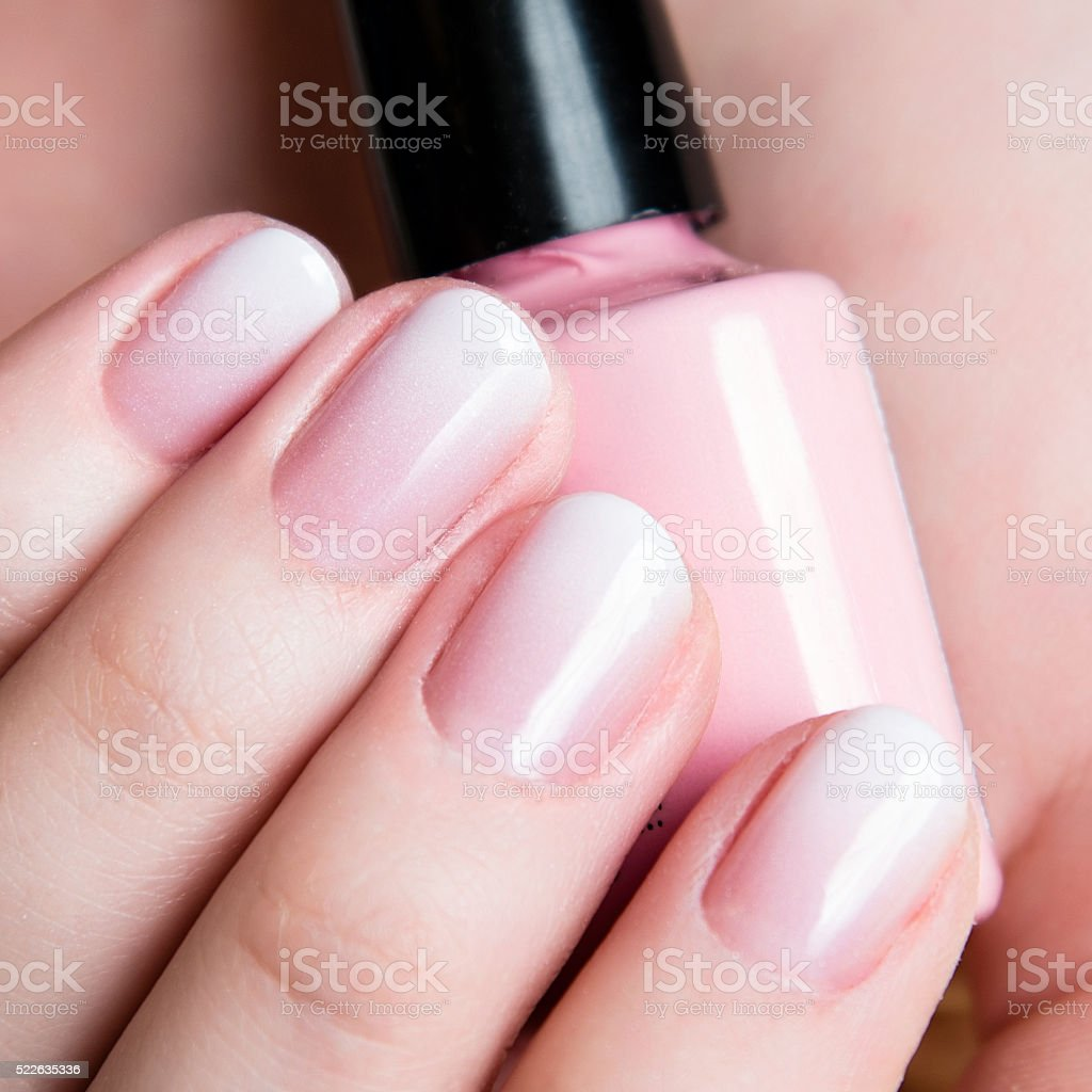 Beautiful healthy natural nails. Beauty long woman nails close up stock photo