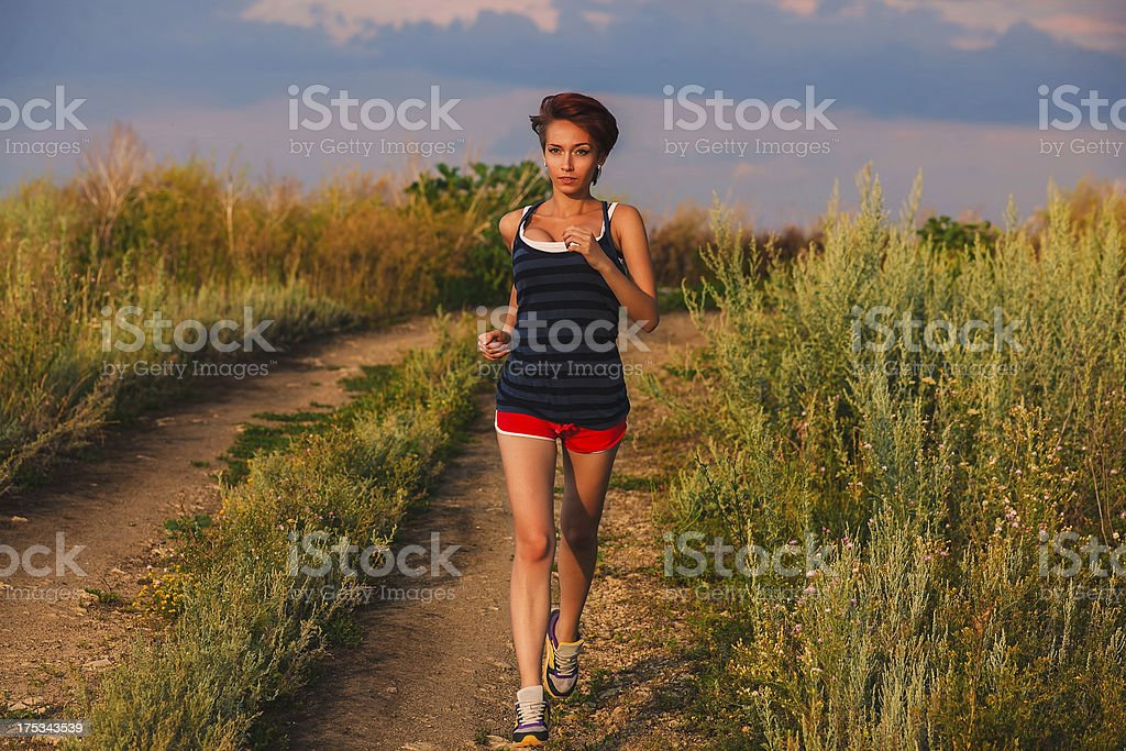 beautiful healthy runs young brunette a woman athlete running ou royalty-free stock photo