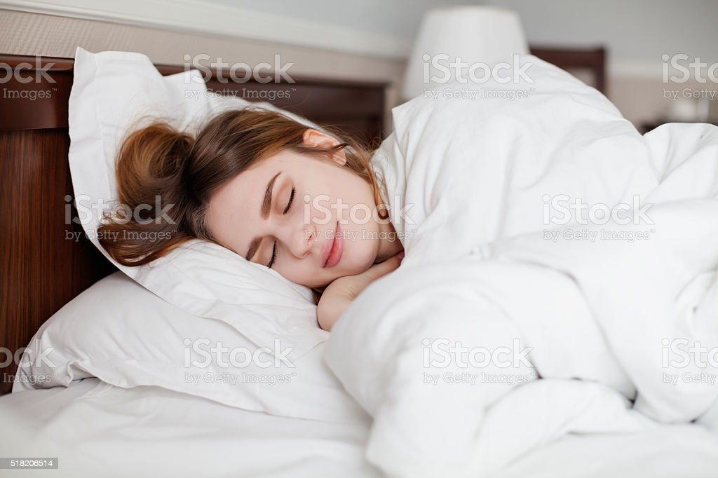 Beautiful healthy woman sleep in hotel number stock photo