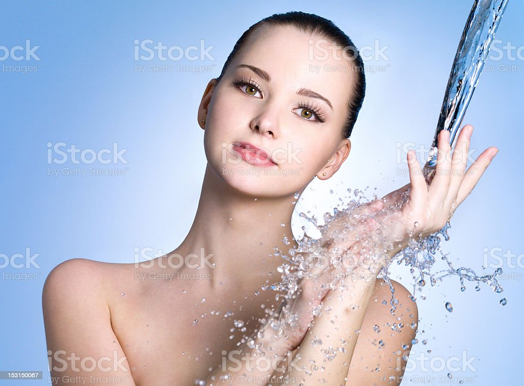 Beautiful healthy woman under stream of water royalty-free stock photo