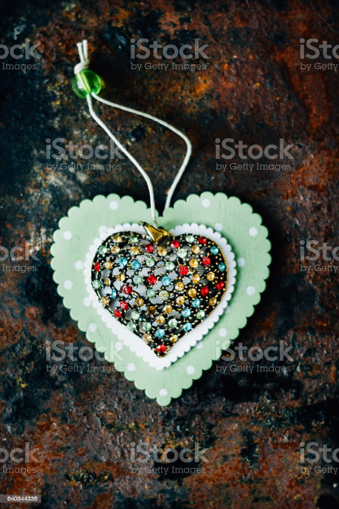 Beautiful heart made from metal and presicous stounes on black stock photo