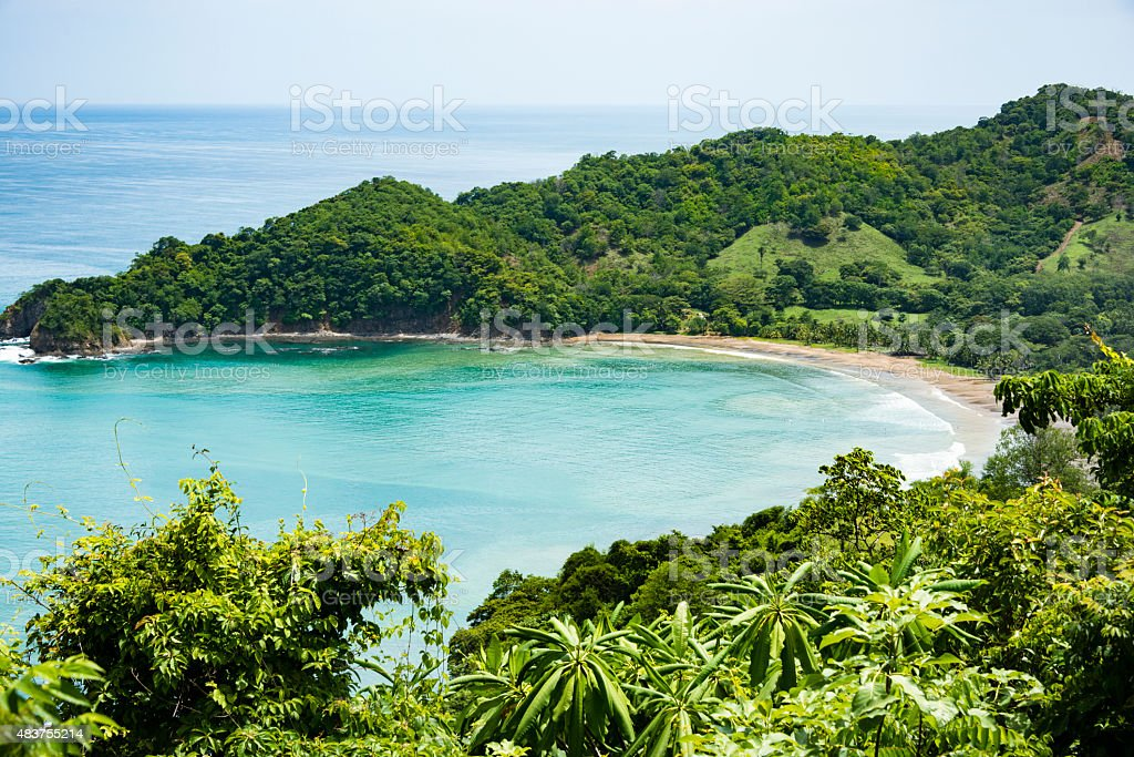 XXXL: Beautiful hidden beach surrounded by green hills and forest stock photo