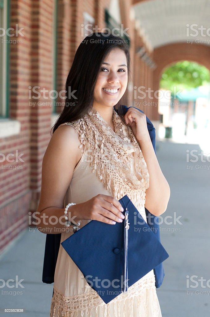 Beautiful high school graduate stock photo