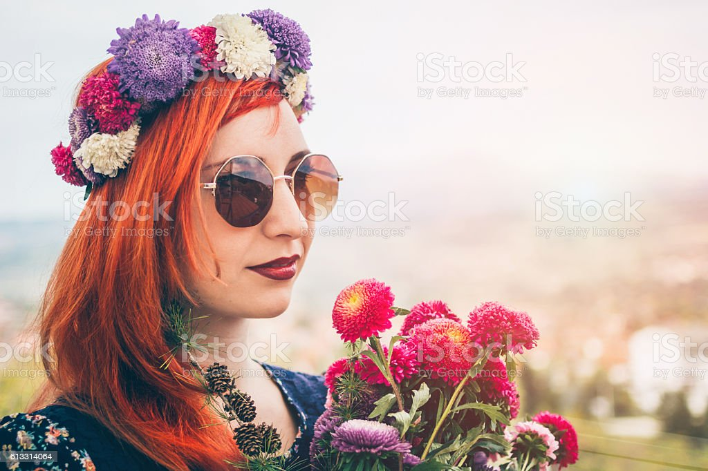 Beautiful hippie bohemian style woman in floral wreath stock photo